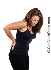 Woman Back Pain - Woman bends over and flinches in pain in...