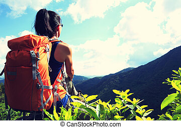 woman backpacker on mountain peak enjoy the view,vintage effect
