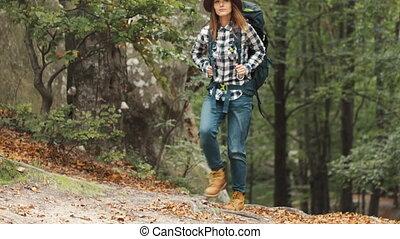 Woman Backpacks through Mountains
