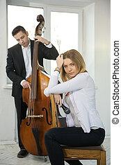 Woman backwards on chair adjust long hairs