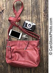 woman bag stuff, handbag over rustic wooden background