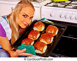 Woman bake cookies at kitchen. - Young blond smilig woman ...