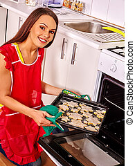 Woman bake cookies on kitchen. - Young smiling woman bake ...