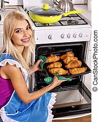 Woman bake cookies - Young blond smilig woman bake cookies. ...