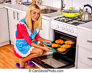 Woman bake cookies - Young woman bake cookies at home ...