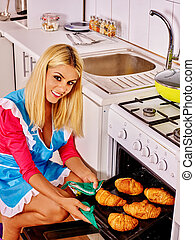 Woman bake cookies - Young woman bake cookies in stove in ...