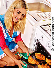 Woman bake cookies - Young woman baking cookies on home ...