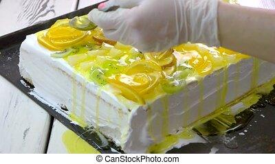 Woman baker making an appetizing dessert. Confectioner ...