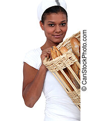 Woman baker with a basket of bread