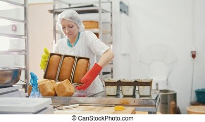 Woman bakes bread on commercial kitchen, close up
