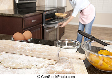 Woman baking a pie
