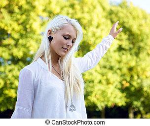 Woman balancing in park