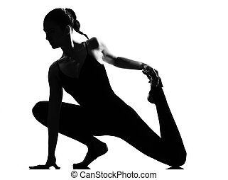 woman ballet dancer stretching warming up