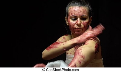 Woman bandaging wounds - Footage of bandaging woman on black...