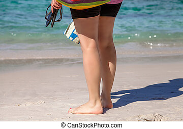 Woman barefoot on sand