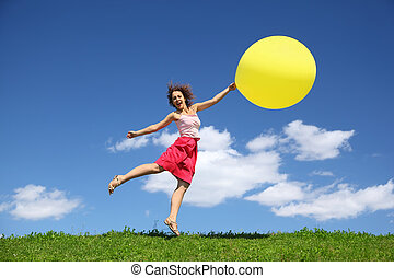 Woman barely touching earth flight away on balloon