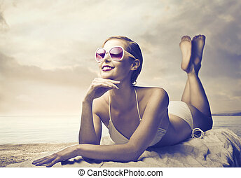 woman beach - beautiful woman lying on the sand