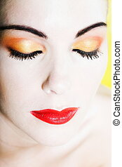 Woman Beauty eyes closed with colorful make up portrait