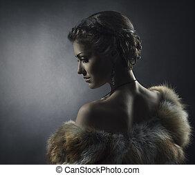 Woman beauty in luxury fox fur coat, beautiful girl retro vintage style