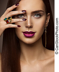 Woman Beauty Makeup, Nails Lips Eyes, Model Covering Face Make Up by Hand with Ring Jewelry