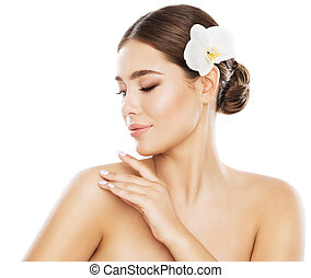 Woman Beauty Skin Care, Model Touch Shoulder by Hand Isolated over White Background, Orchid Flower in Straight Hair, Skincare Concept