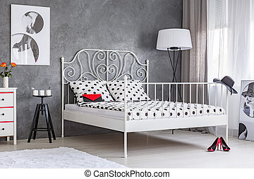 Woman bedroom with large bed