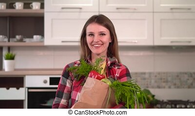 Woman Been Shopping for Healthy Food - Tall and slim woman,...