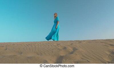 Woman beginning free life - Young woman on beach skyline...