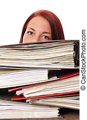 Woman behind a montain of folders in a office