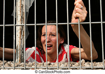 woman behind bars crying