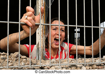 woman behind bars