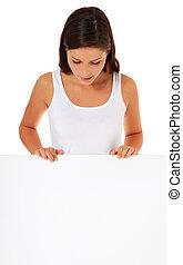 Woman behind blank board