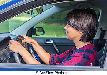 Woman behind steering wheel in car