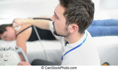 Woman Being Checked at Ultrasound Device - Woman being...