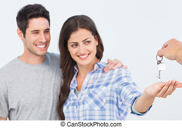 Woman with her husband being given a house key