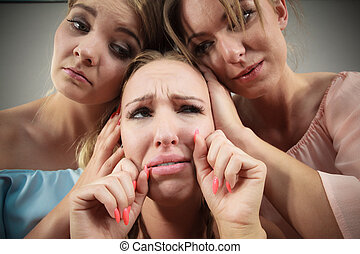 Woman being mad at two females