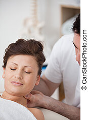 Woman being massaging her head while raising it