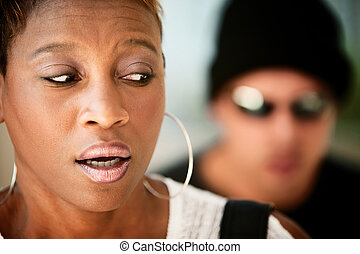Woman being stalked - African-American woman being stalked...