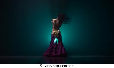 Woman belly dancer arabian dancing. Smoke background. Slow...