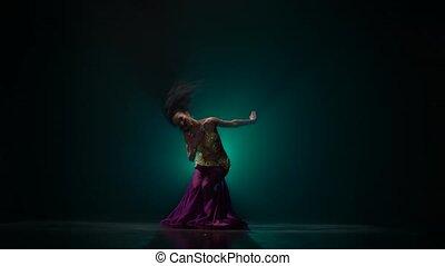 Woman belly dancer arabian dancing . Smoke background -...