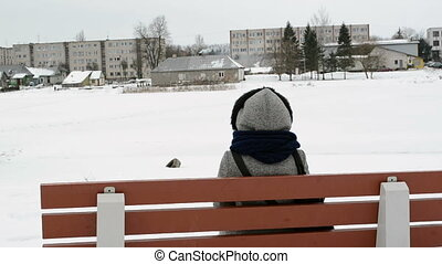 woman bench winter house - woman with coat sit on wooden...
