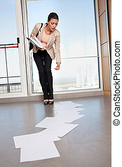 Woman Bending Down to Collect Papers on Floor - Beautiful...