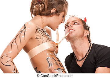 woman  between a beautiful angel and devil man