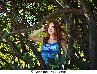 Woman between tree branches