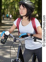 woman biker with mountain bike