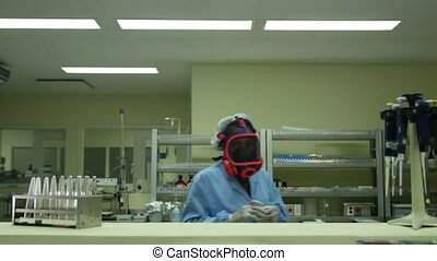 Woman, biotech, pharmaceutical lab - Hazardous and dangerous...