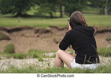 Woman birdwatching for Sandmartins