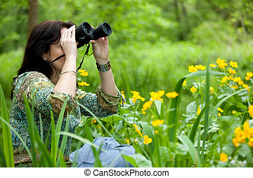 woman birdwatching - woman in beautiful park watching...