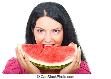 Woman biting a slice of watermelon