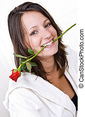 Woman biting rose
